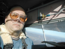 Here is our intrepid aviator on the first leg of the flight, somewhere just south of Astoria, Oregon. The fuel tank valve which figures prominently in the story sits innocently next to my head.