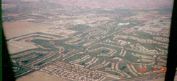 Palm Springs, California. Some people would look at this photo and see a bunch of golf courses for snobby, hilarious idiots with white plaid polyester pants. I look at it and see a bunch of short grass strips for idiots with hilarious old airplanes covered with the same white polyester.