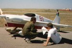 Air Racing in Albuquerque :: Flying the Formula One racer #81 Boo Ray at the 1988 Albuquerque Air Races, held at the then-brand new Double Eagle airport about 15 miles west of the city. Your intrepid author in a military surplus store fireproof flight suit on the left, with crew chief Rob Baker on the right.